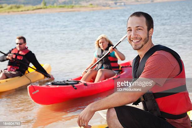 Young man with friends outside kayaking
