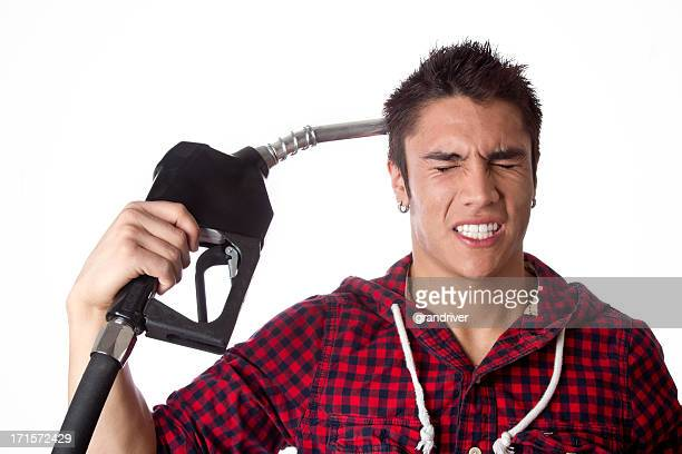 Young Man with Gasoline Nozzle Gesturing Suicide