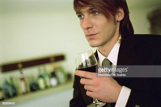 Young man with glass of wine