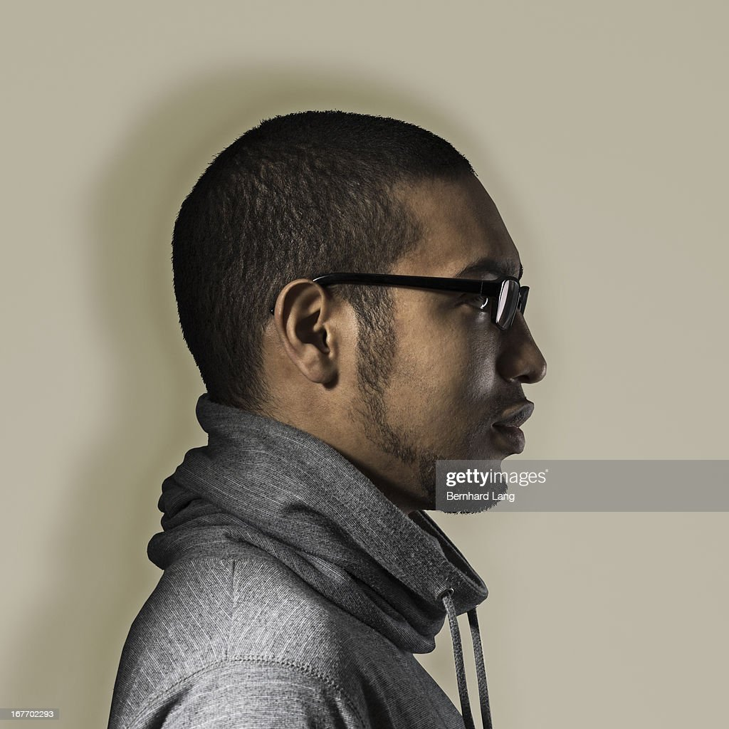 Young man with glasses, close-up, profile : Stock Photo