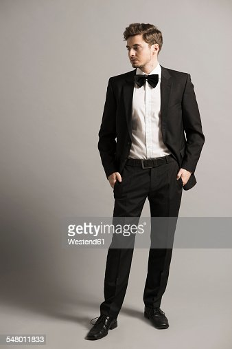 Portrait Of Young Man Wearing Black Suit White Shirt And Bow Stock ...