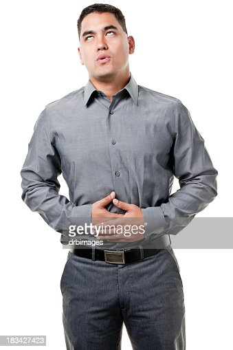 Young Man With Hands On Stomach