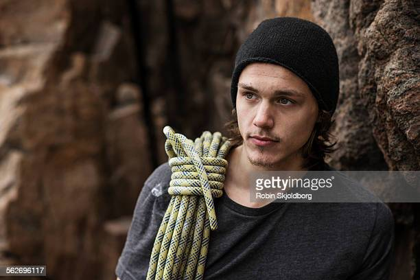 Young Man with hat and rope across shoulder