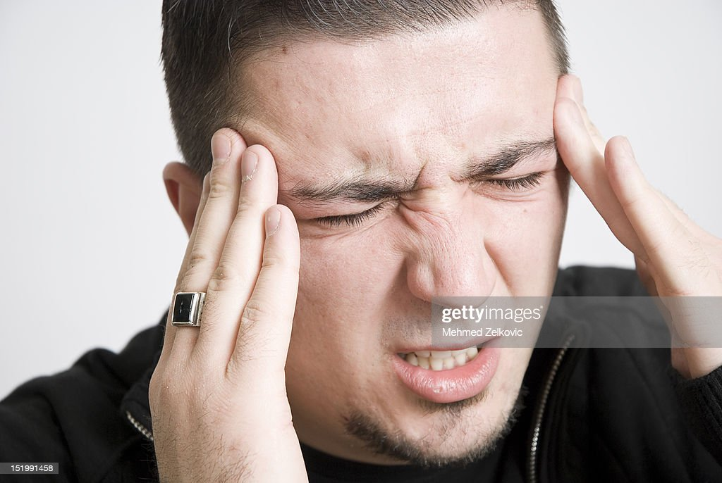 Young man with headache : Stock Photo