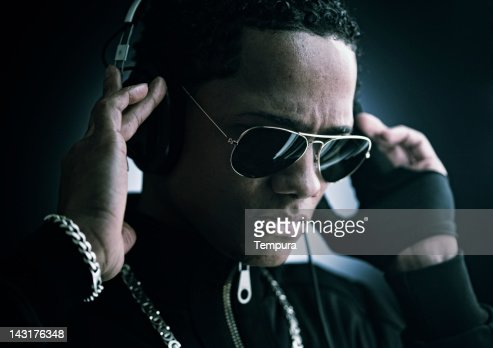 Young man with headphones and sunglasses _ horizontal