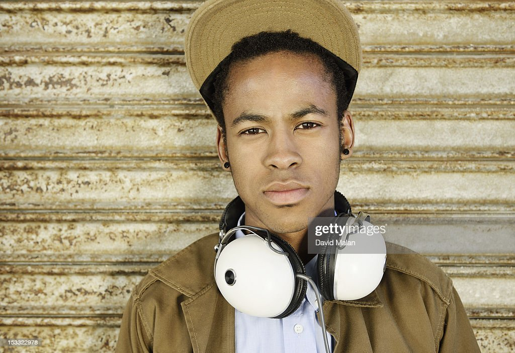Young man with headphones around his neck. : Stock Photo