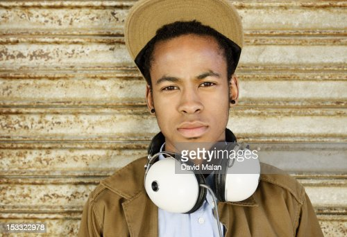 Young man with headphones around his neck. : Foto de stock