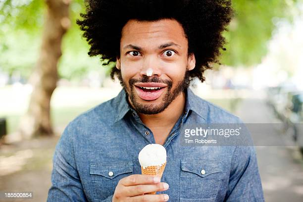 Young man with ice cream on his nose.