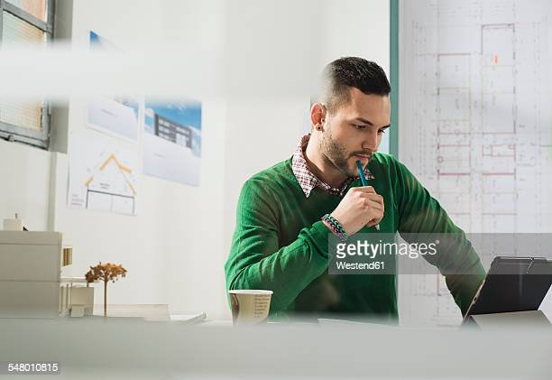 Young man with laptop at desk