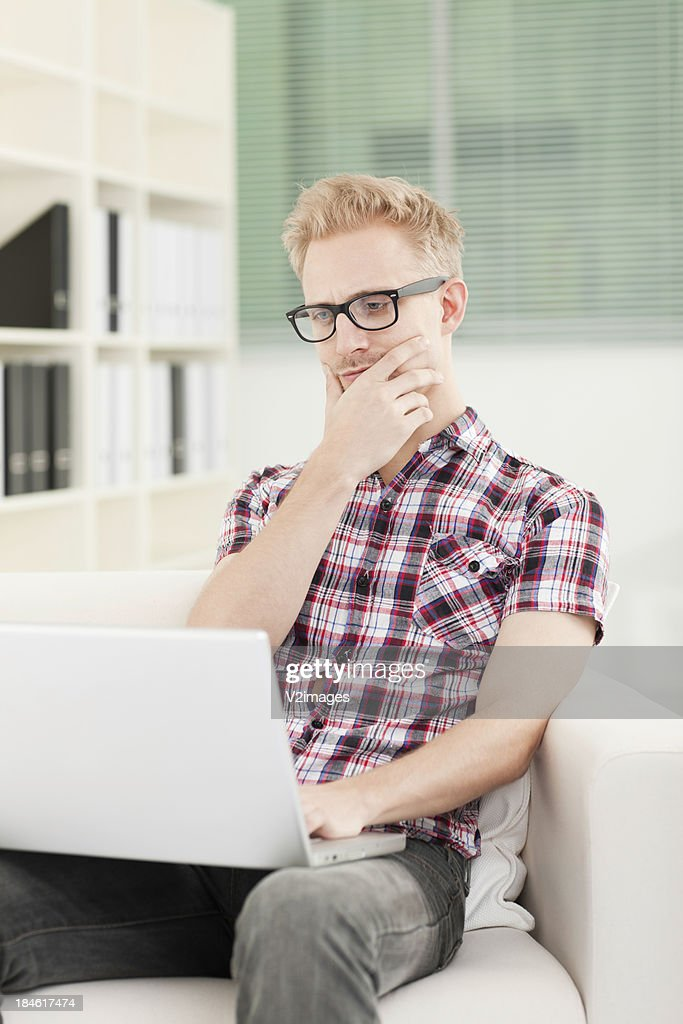 Young Man With Laptop : Stock Photo