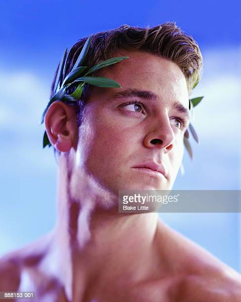 Young man with laurel leaves in hair, close-up