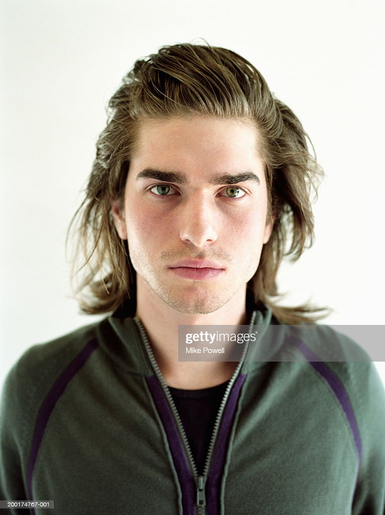 Young man with long brown hair, portrait : Stock Photo