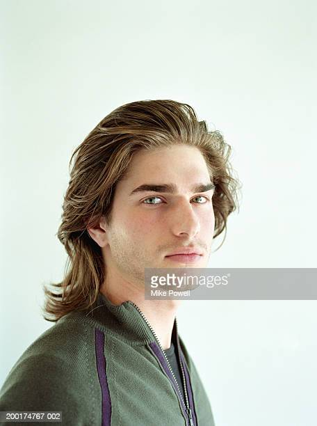 Young man with long brown hair, portrait
