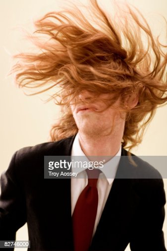 young man with long hair covering face : Stock Photo