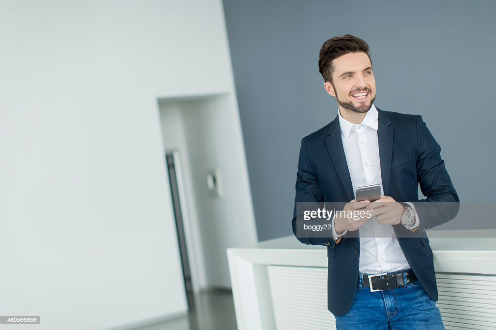 Young man with mobile phone : Stock Photo