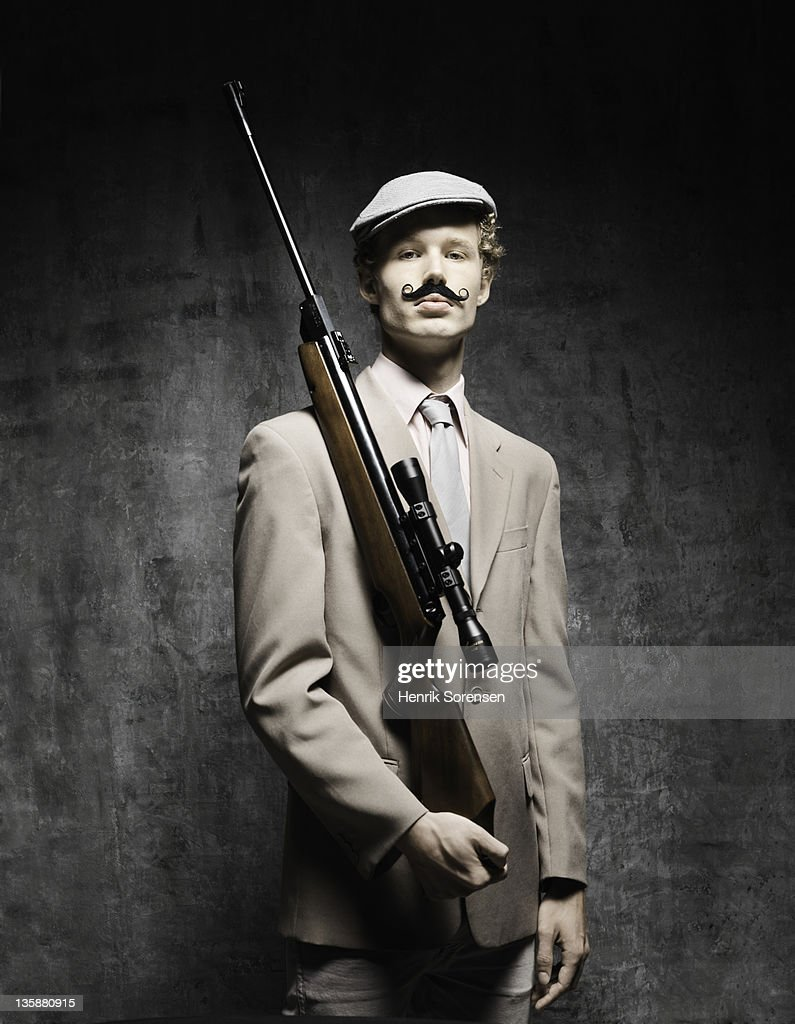 young man with moustache and riffle : Stock Photo