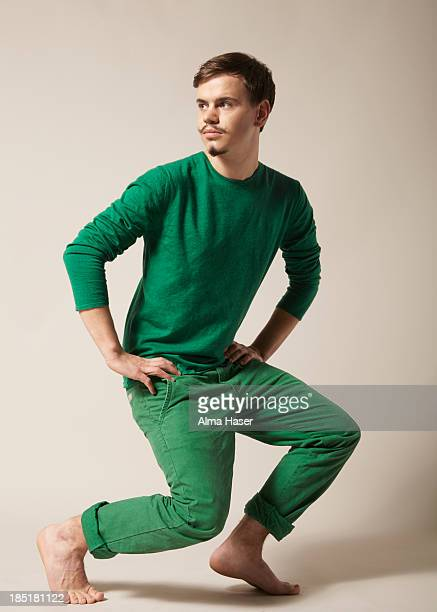 Young man with moustache in green clothes