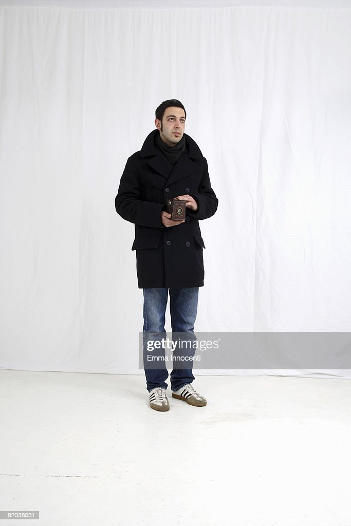 Young man with old camera