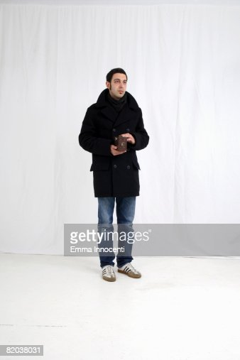 Young man with old camera : Stock Photo