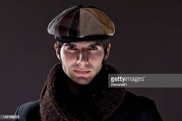 Young man with scarf and cap, portrait