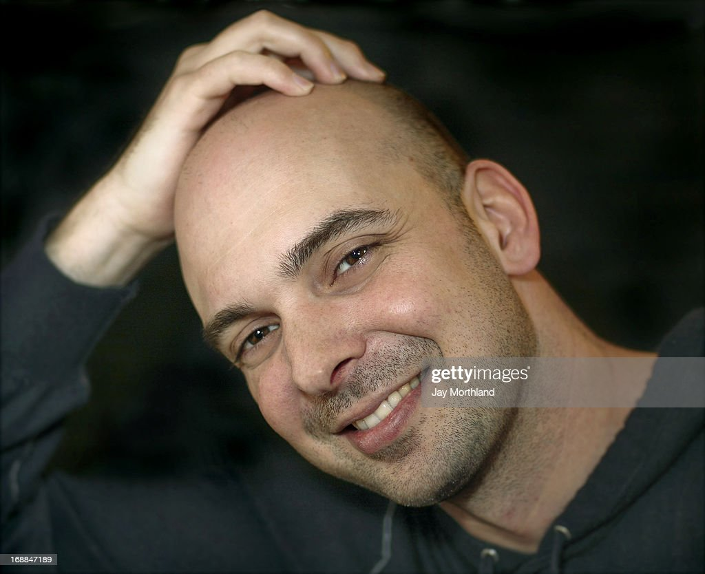 Young Man With Shaved Head Stock Photo | Getty Images
