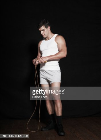 Young man with skipping rope : Stock Photo