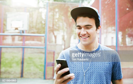 Young man with smart phone and headphones