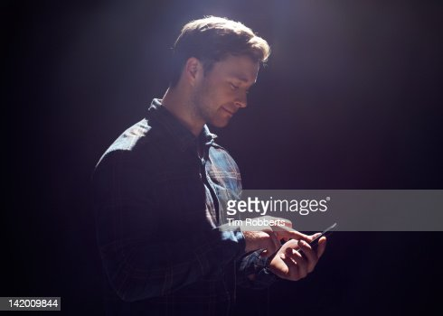 Young man with smart phone.