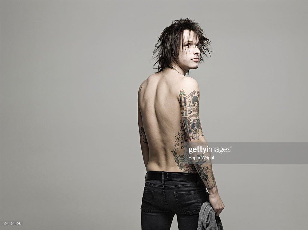 Young man with tattoos : Stock Photo