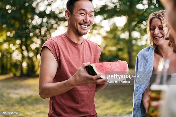 Young man with Watermelon at cookout