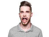 Funny concept for man with windblown mouth. Man looking at camera. Isolated on white background