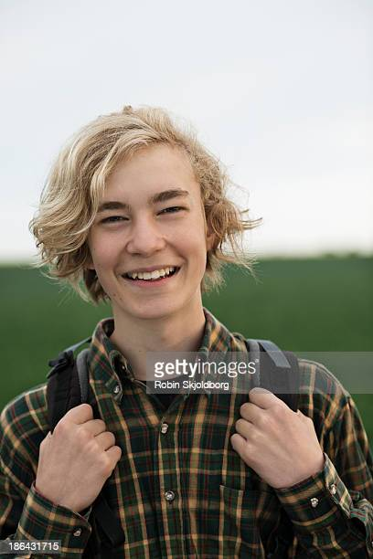 Young man with with rucksack smiling