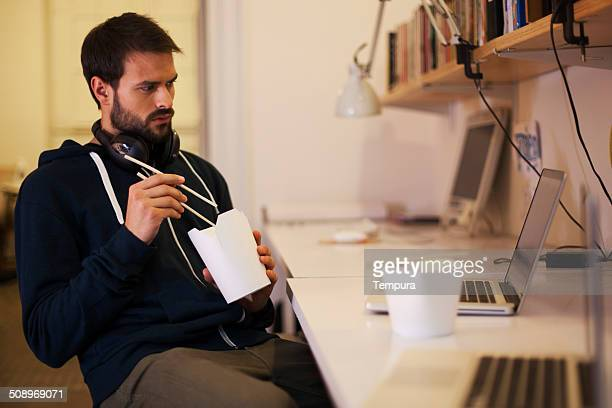 Young man working after hours in a startup office