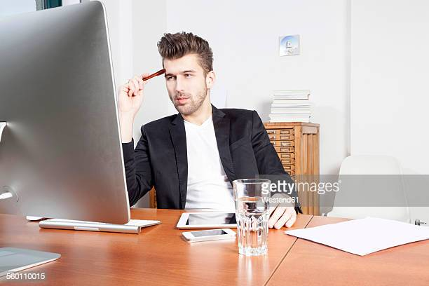 Young man working at desk in an office