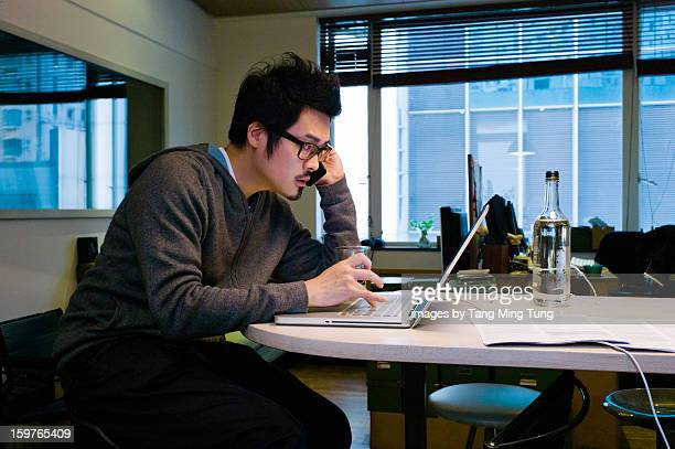 Young man working at home office with a laptop