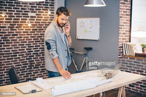 Young man working at modern office space.