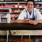 Young Man Working in a Butcher Shop