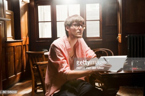 young man working in cafe. : Stock Photo