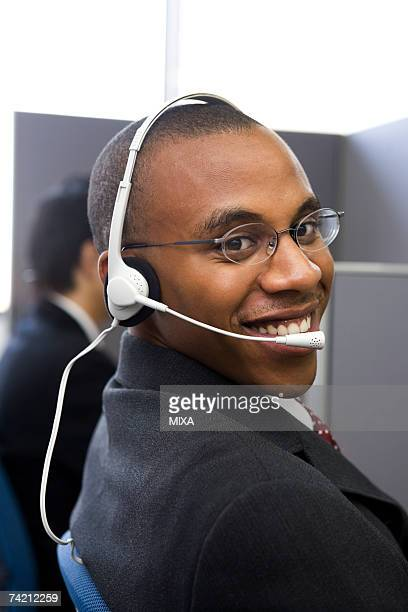 Young man working in call center