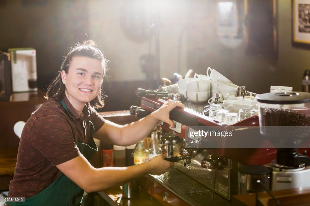 Young man working in coffee shop : Stock Photo