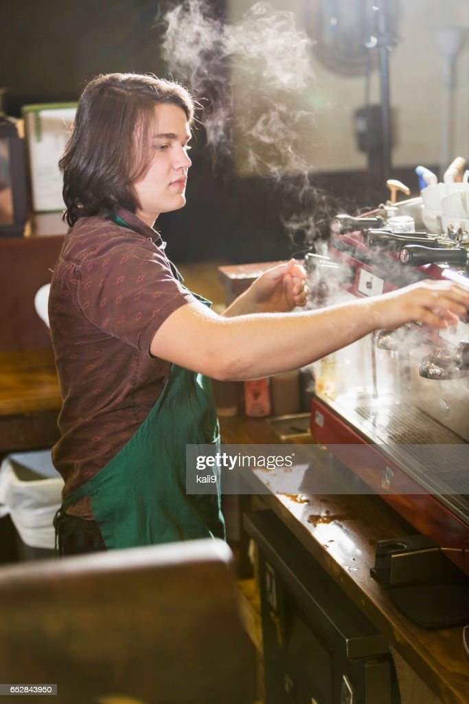 Young man working in coffee shop : Stock-Foto