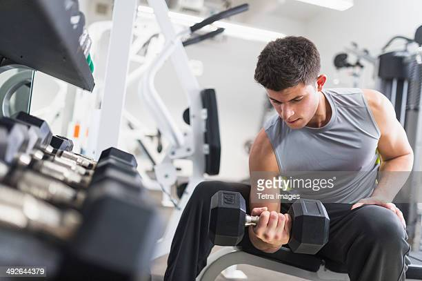 Young man working out at gym, Jersey City, New Jersey, USA