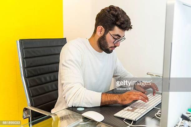 Young man working with computer in an office