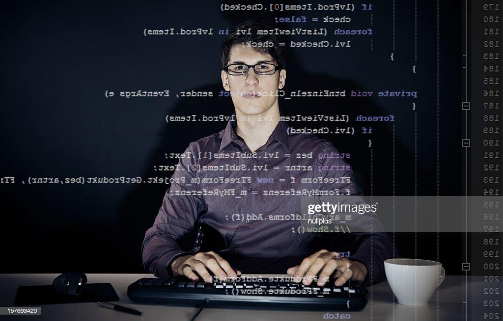 young man writing a c# program