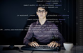 young man writing a c# program