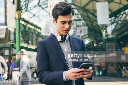 Young Man Writing On Smartphone
