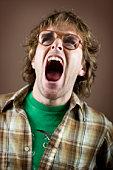 Young man yelling, close-up