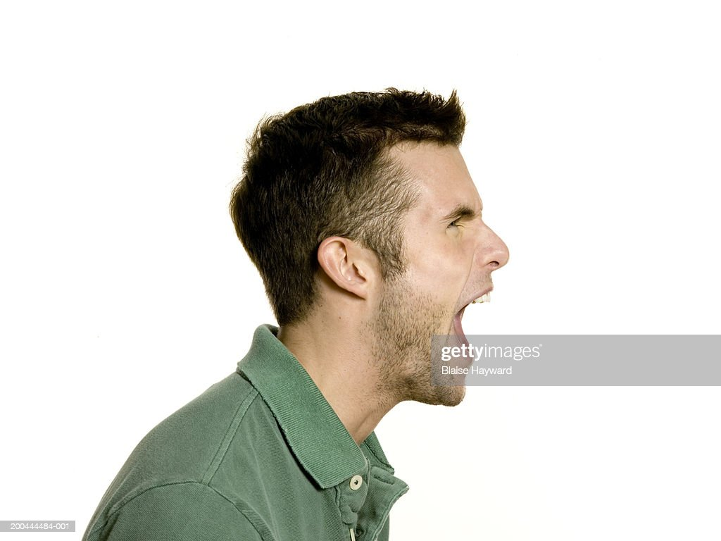 Young man yelling, side view