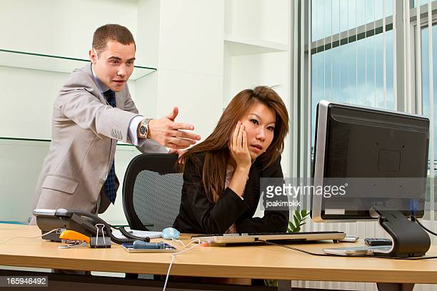 Young manager having an argument with his secretary