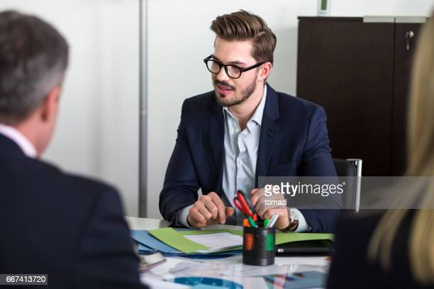 Young manager in meeting